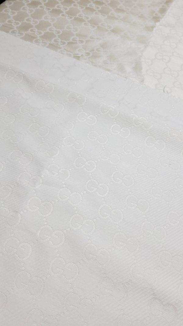 embossed logo brocade fabric