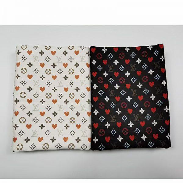 French designer brocade fabric LV logo